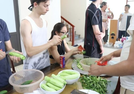 peeling cucumber hanoi rural home cooking class